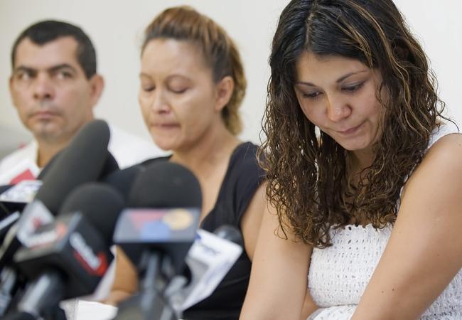 The family of Fredy Villanueva, father Gilberto, mother Lilian and sister Patricia Villanueva, speak at a news conference in Montreal on Friday, Aug. 15, 2008. (Peter McCabe / THE CANADIAN PRESS)