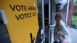 Voters head to the polls on election day in Carleton Place, Ont. on Thursday, June 12, 2014. (Sean Kilpatrick / THE CANADIAN PRESS)