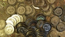 This April 3, 2013 photo shows bitcoin tokens in Sandy, Utah. (AP/Rick Bowmer)