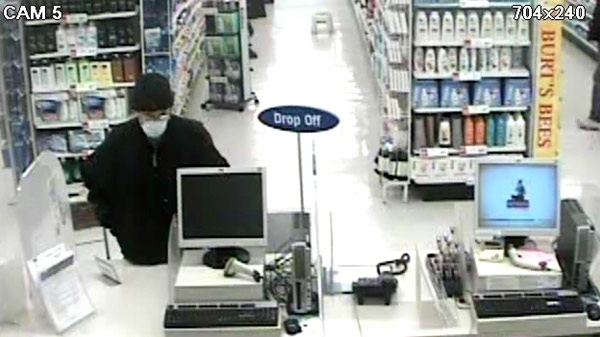 A suspect sought in a robbery at a drug store in Cambridge, Ont. is seen in this image taken from security video on Monday, Dec. 5, 2011. (Courtesy WRPS)