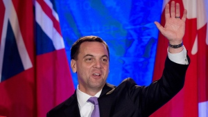 Ontario Progressive Conservative leader Tim Hudak, right, announces that he will be stepping down as party leader after being defeated his election night campaign head quarters as his wife Deb Hutton looks on, in Grimsby, Ont., on Thursday, June 12, 2014. (Nathan Denette / THE CANADIAN PRESS)