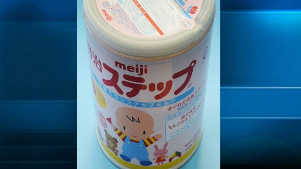 In this photo taken Tuesday, Dec. 6, 2011, a canned powdered milk for infants Meiji Step, manufactured and sold by Japan's major food and candy maker Meiji Co., is shown.