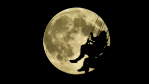 "In this file photo, a fair-goer is silhouetted against a full moon while riding the ""Atmosfear"" attraction at the Pacific National Exhibition in Vancouver, B.C., on Tuesday August 20, 2013. (THE CANADIAN PRESS/Darryl Dyck)"