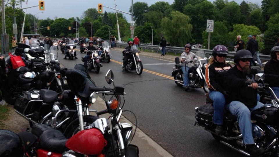 Motorcycle riders arrive in Port Dover, Ont. for a rally on Friday, June 13, 2014.