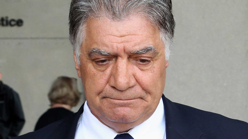 London Mayor Joe Fontana leaves the courthouse in London, Ont., after hearing the guilty verdict in his fraud trial on Friday June 13, 2014. (THE CANADIAN PRESS/Dave Chidley)