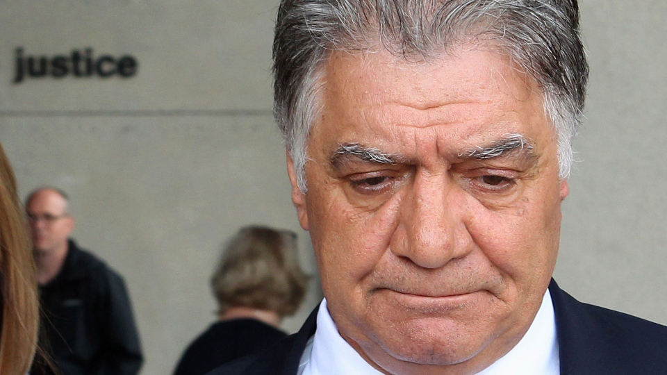 Then-London mayor Joe Fontana walks away from the London, Ont., courthouse after hearing the verdict in his fraud trial on Friday June 13, 2014. (Dave Chidley / THE CANADIAN PRESS)