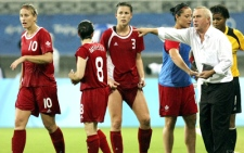 Canada's head coach Even Pellerud directs his players just before the extra time of a women's quarterfinal match against the U.S. at the Beijing 2008 Olympics in Shanghai, Friday, Aug. 15, 2008. U.S. beat Canada 2-1. (AP / Eugene Hoshiko)