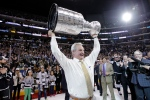 Los Angeles Kings head coach Darryl Sutter raises the Stanley Cup after the Kings beat the New York Rangers in Game 5 of the NHL Stanley Cup Final series, in Los Angeles, Friday, June 13, 2014. (AP / Jae C. Hong)