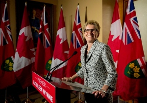 Ontario Premier Kathleen Wynne speaks to the media after winning a majority government at Queen's Park in Toronto on Friday, June 13, 2014. (Nathan Denette / THE CANADIAN PRESS)