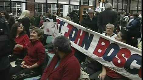 St. John Bosco parents fought Wednesday to keep the school open.