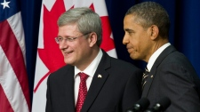 Prime Minister Stephen Harper and U.S. President Barack Obama leave a news conference following a meeting at the White House in Washington on Wednesday, Dec. 7, 2011. (Paul Chiasson / THE CANADIAN PRESS)