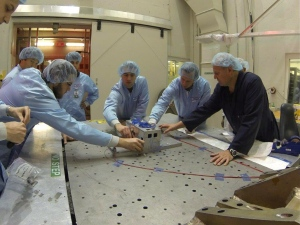 University of Victoria students, who won a contest involving universities across Canada, work on a small satellite in a handout photo. (The Canadian Press)