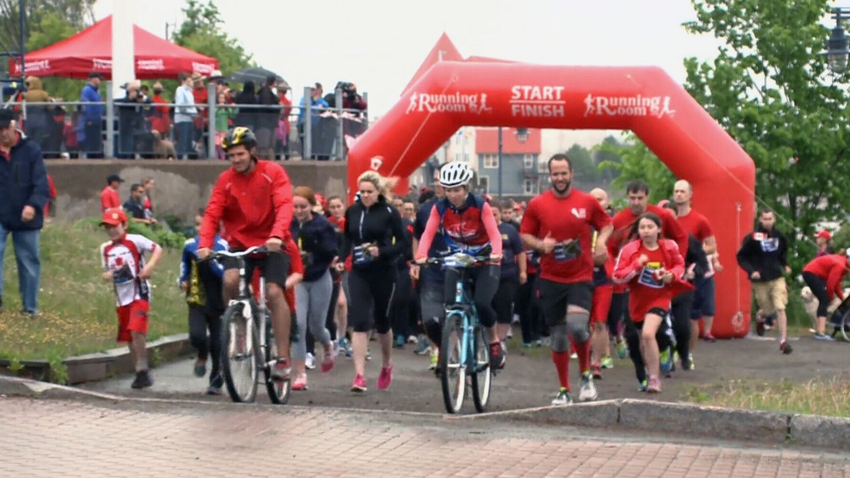 Participants begin the '3km Run for 3 Fathers: RCMP Memorial Father's Day Run' in Moncton, N.B., on Sunday, June 15.