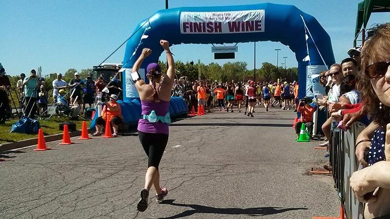 A race participant crosses the finish line at the Niagara Falls Women's half-marathon. (Angela Mulholland / CTVNews.ca)