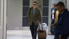 Actor Alec Baldwin is seen in an airport in New York, just hours after being kicked off an American Airlines flight, Tuesday, Dec. 7, 2011.