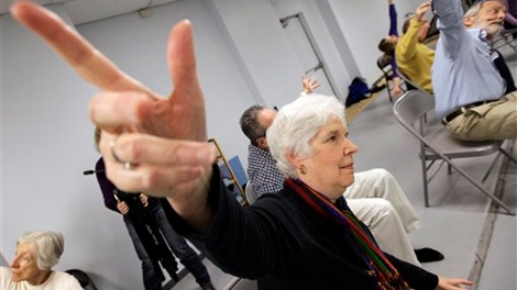 Rosyln Lieb, center, works on during a dance class therapy for Parkinson�s at the Hubbard Street Dance Center on Saturday, Nov. 5, 2011 in Chicago. (AP Photo/Nam Y. Huh)