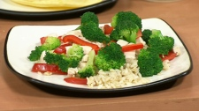 Peanut Chicken Stir-Fry with Red peppers and Broccoli over Brown Rice.