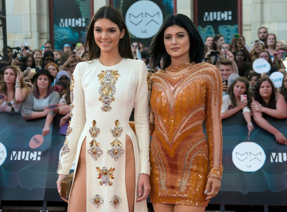 Kendall and Kylie Jenner arrive on the red carpet at the 2014 Much Music Video Awards in Toronto on Sunday June 15, 2014. (Aaron Vincent Elkaim / THE CANADIAN PRESS)