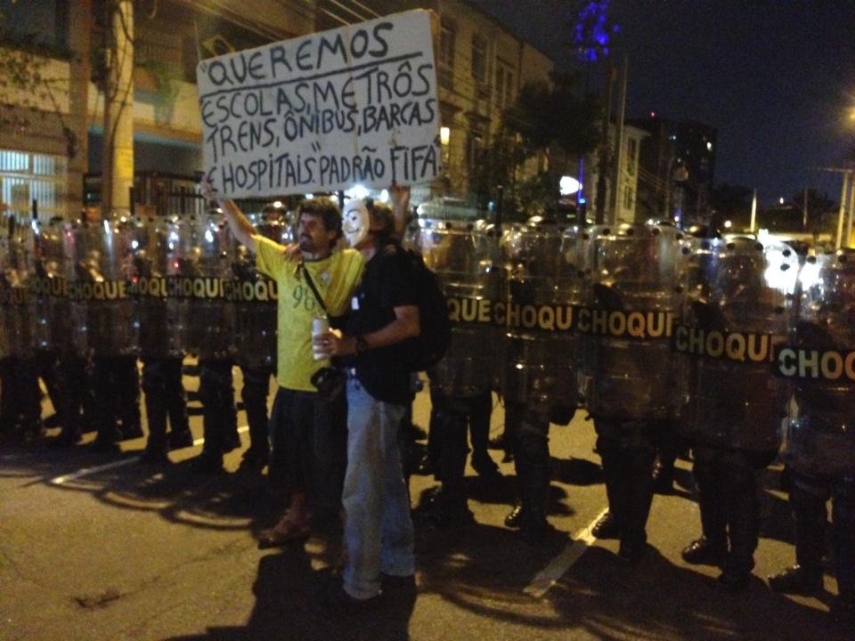 Protesters stand in front of police on Sunday, June 15 near Rio de Janeiro's Maracana soccer stadium. (Peter Akman/CTV)