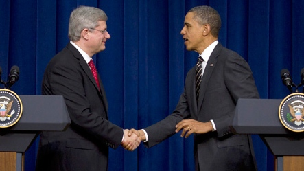 Prime Minister Stephen Harper shakes hands with U.S. President Barack Obama