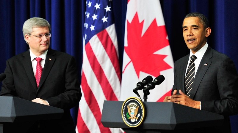 Prime Minister Stephen Harper and U.S. President Barack Obama hold a news conference following a meeting at the White House in Washington, D.C., Wednesday, Dec.7, 2011. (Paul Chiasson / THE CANADIAN PRESS)