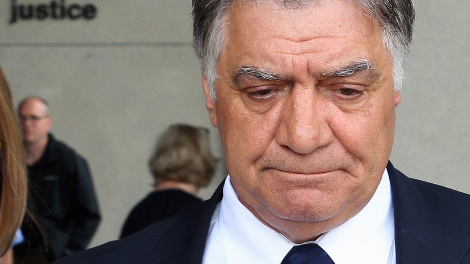 London Mayor Joe Fontana walks from the London, Ont., courthouse after hearing the verdict in his fraud trial, Friday, June 13, 2014. (Dave Chidley / THE CANADIAN PRESS)