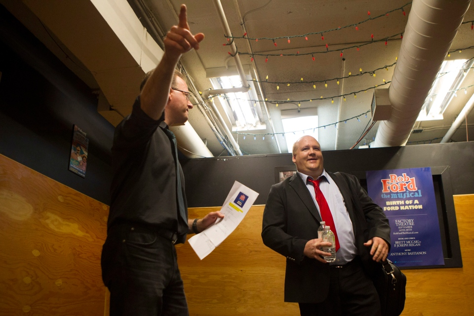 Actor Geoff Stone, right, is given instructions during an open audition for 'Rob Ford the Musical' in Toronto on Monday, June 16, 2014. (Chris Young / THE CANADIAN PRESS)