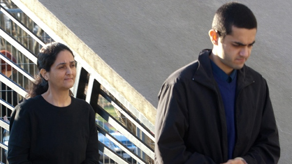 Tooba Mohammad Yahya and Hamed Shafia, right, leave the holding cell at the Frontenac county courthouse in Kingston, Ontario on Thursday Dec. 8, 2011. (Lars Hagberg / THE CANADIAN PRESS)