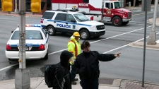 Police closed several streets in downtown Dartmouth, N.S., as high winds blew construction material off a roof top on Thursday, Dec. 8, 2011. (Andrew Vaughan / THE CANADIAN PRESS)