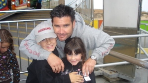 Bryan Stow holding his 12-year-old son and 8-year-old daughter in this undated image provided Tuesday April 5, 2011. (AP / John Stow)