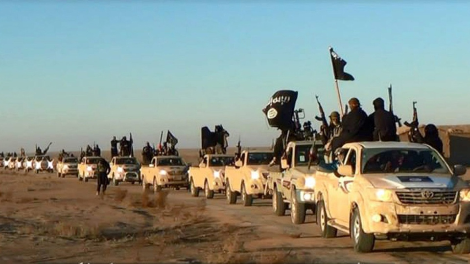 This file image posted on a militant website on Tuesday, Jan. 7, 2014, which is consistent with AP reporting, shows a convoy of vehicles and fighters from the al Qaeda-linked Islamic State of Iraq and al-Sham (ISIS) in Iraq's Anbar Province.
