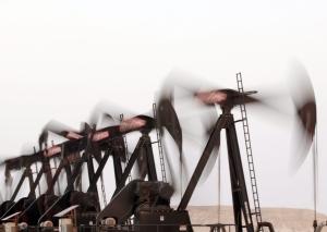 A row of oil pumps work in the desert oil fields of Sakhir, Bahrain on Tuesday, June 10, 2014. (AP  / Hasan Jamali)