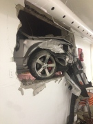 The front-end of a Dodge Caliber that struck the Fuente De Vida Church on Seminole Street can be seen from within the church's basement on Tuesday, June 17, 2014. (Marvin Calito/ Viewer photo)