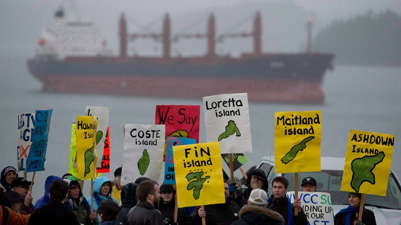 A group of protesters gathers outside the Northern Gateway hearings in Prince Rupert, B.C. on December, 10, 2012. (THE CANADIAN PRESS/Jonathan Hayward)