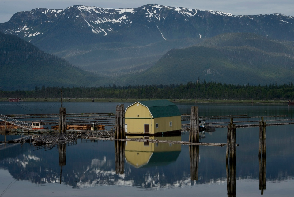 Snowcapped mountains are reflected in the waters of Kitimat, B.C. Tuesday, June, 17, 2014. (Jonathan Hayward / THE CANADIAN PRESS)