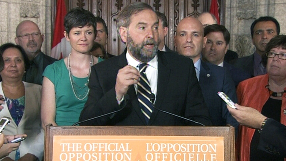NDP Leader Tom Mulcair reacts to the federal government's decision to approve the Northern Gateway pipeline, in Ottawa, Tuesday, June 17, 2014.