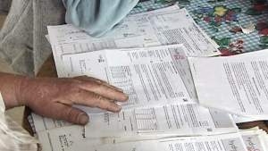In this file photo an Ontario resident reviews his hydro bills. (CTV Northern Ontario)