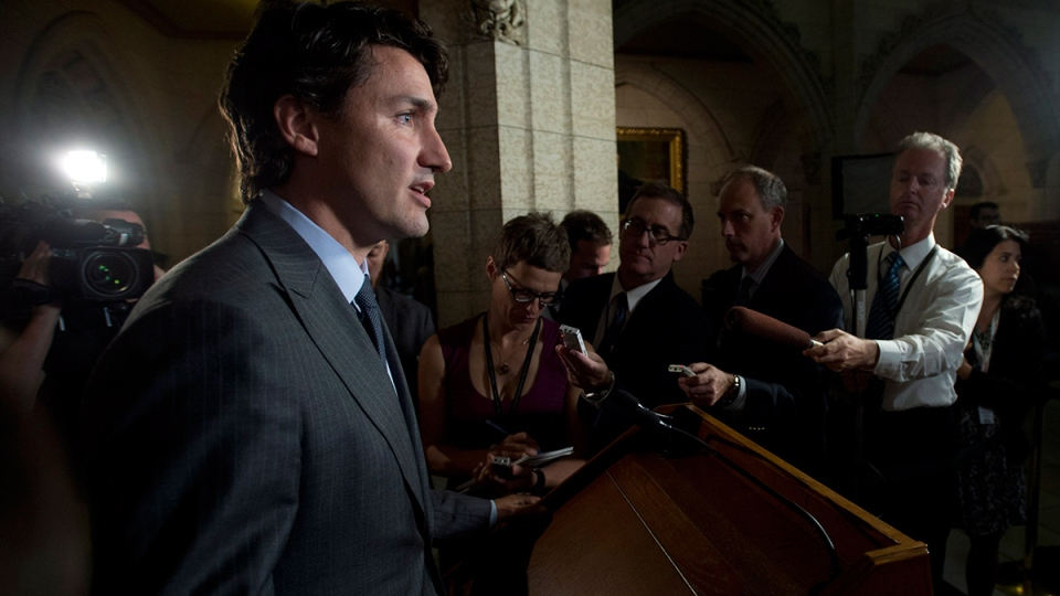 Liberal leader Justin Trudeau respond to the government's decision to approve the Northern Gateway pipeline, in Ottawa, Tuesday, June 17, 2014. (Adrian Wyld / THE CANADIAN PRESS)