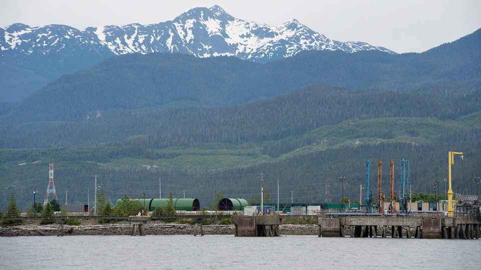 Snow-capped mountains are seen in the background of the harbour in Kitimat, B.C. Tuesday, June, 17, 2014. (Jonathan Hayward / THE CANADIAN PRESS)