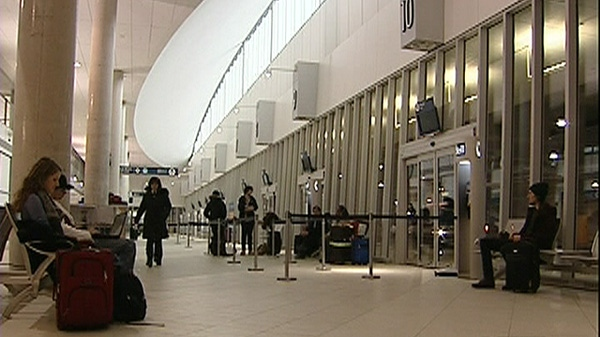 Passengers wait for buses at the new Ilot Voyageur bus terminal (Dec. 8, 2011)