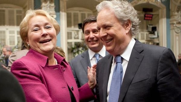 Quebec Opposition Leader Pauline Marois, left, and Premier Jean Charest greet each other as the fall session is about to wrap up Friday, December 9, 2011 at the legislature in Quebec City. THE CANADIAN PRESS/Jacques Boissinot