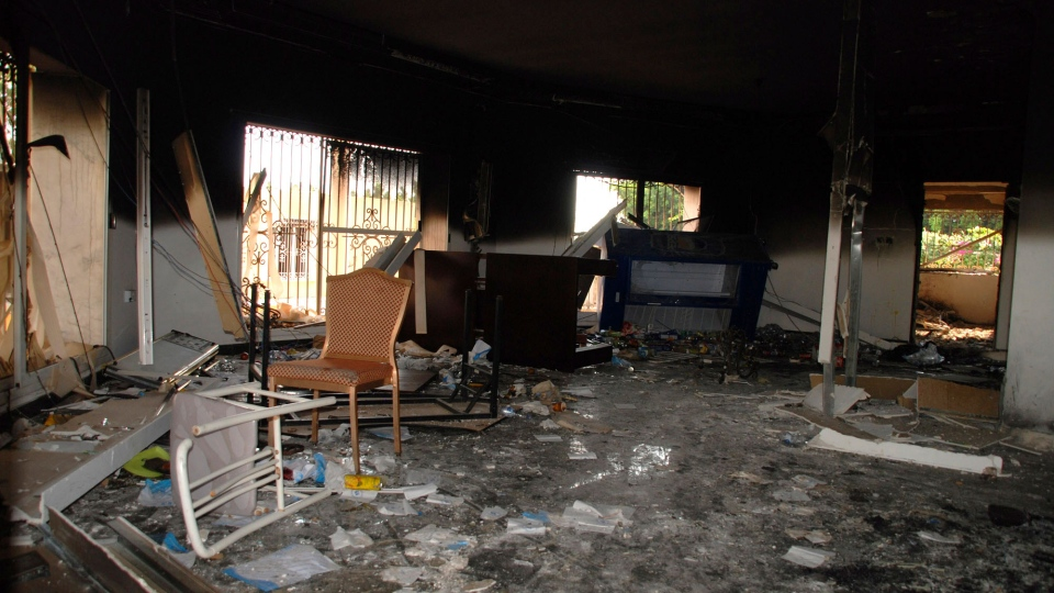 This Sept. 12, 2012 file photo show glass, debris and overturned furniture are strewn inside a room in the gutted U.S. consulate in Benghazi, Libya, after an attack that killed four Americans, including Ambassador Chris Stevens. (AP / Ibrahim Alaguri, File)
