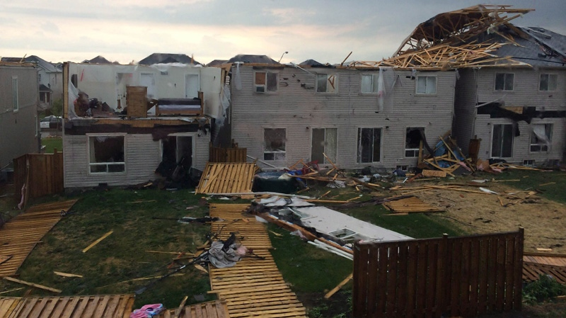 The backyards of homes in Angus, Ontario are shown on Tuesday June 17, 2014. Provincial police say there are reports of some minor injuries after severe weather ripped through the central Ontario community of Angus. (Greg Facchini / THE CANADIAN PRESS)