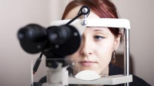 A woman gets an eye exam to test for glaucoma. (Jacek Bieniek/shutterstock.com)