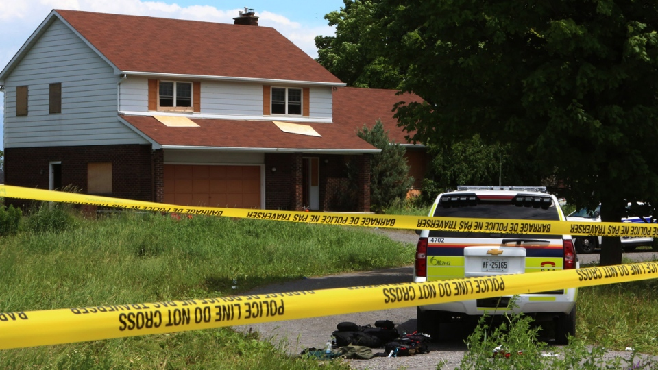 Police tape blocks the scene where two Ottawa Police officers and three paramedics were injured during a training exercise in the Kanata, Ont. in the west end of Ottawa, Wednesday, June 18, 2014. (Fred Chartrand / THE CANADIAN PRESS)