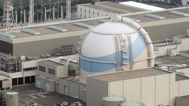 This photo taken in June 2011 shows the No. 3 reactor building of Kyushu Electric Power Co.'s Genkai plant in the town of Genkai, southwestern Japan. Radioactive water leaked inside the nuclear power plant, but the contaminated water did not escape into the environment, the government said Saturday, Dec. 10, 2011. (AP Photo/Kyodo News)