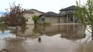 Water from the Highwood River surrounds a High River home in the spring of 2013