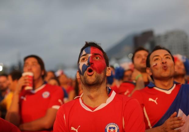 Fans look on in horor as Spain loses