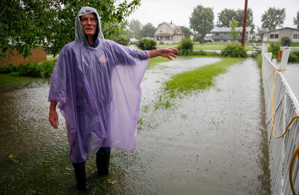 Will Mercier describes the flooding of his home in Claresholm, Alta., Wednesday, June 18, 2014. THE CANADIAN PRESS/Jeff McIntosh