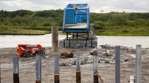 Reconstruction continues on a bridge over the Bow River that was destroyed by flooding one year after a devastating flood in Siksika, Alta., Thursday, June 5, 2014. (Jeff McIntosh / THE CANADIAN PRESS)